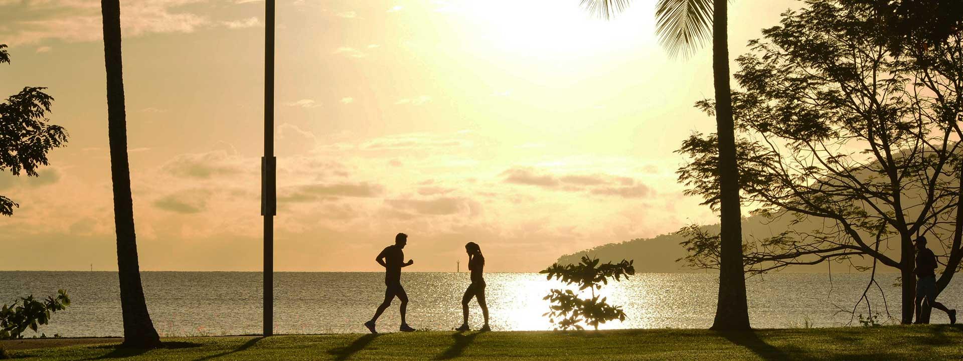 Enjoy a relaxing jog along beaches of Cairns
