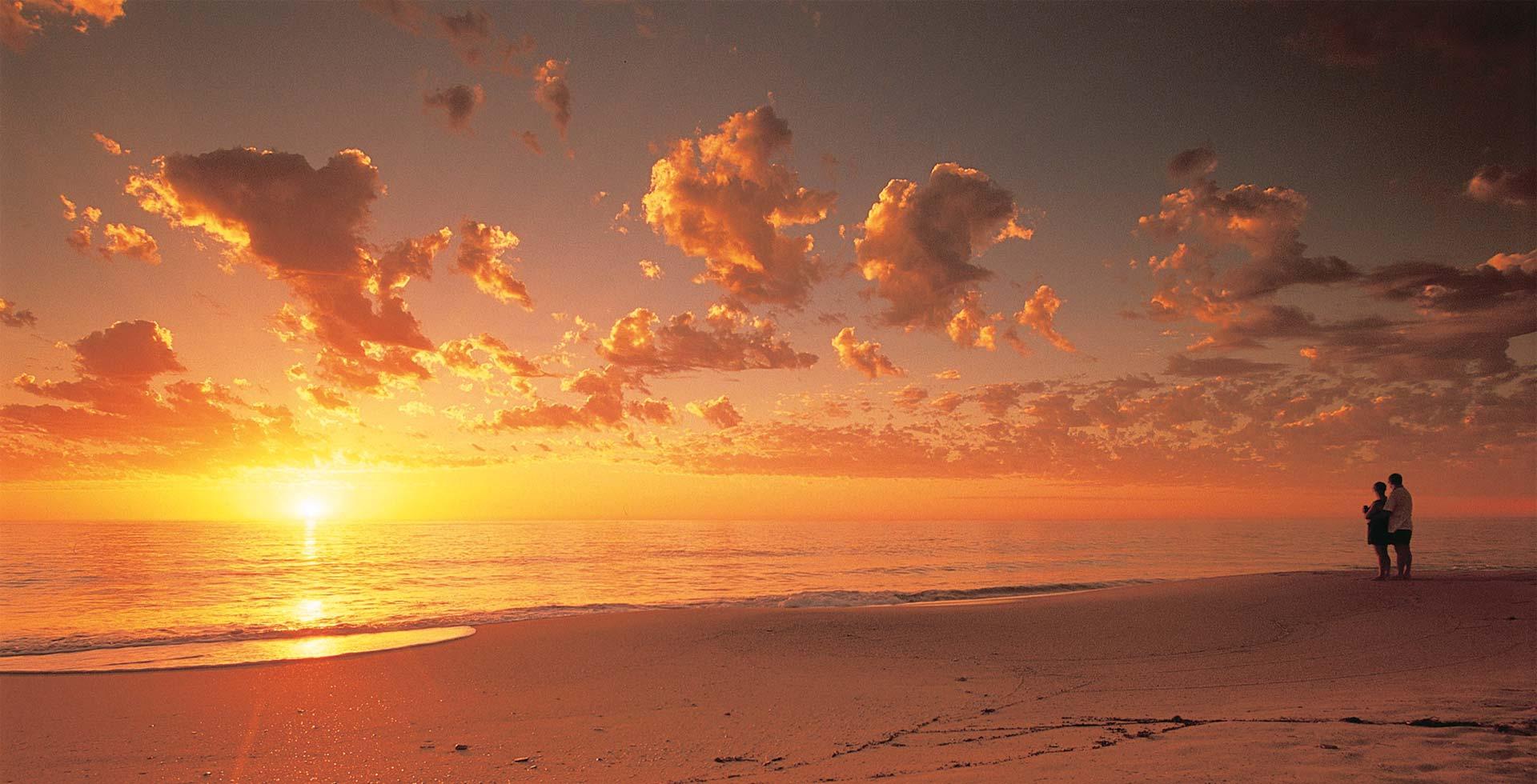 Jog along a striking sunset at Preston Beach in Mandurah