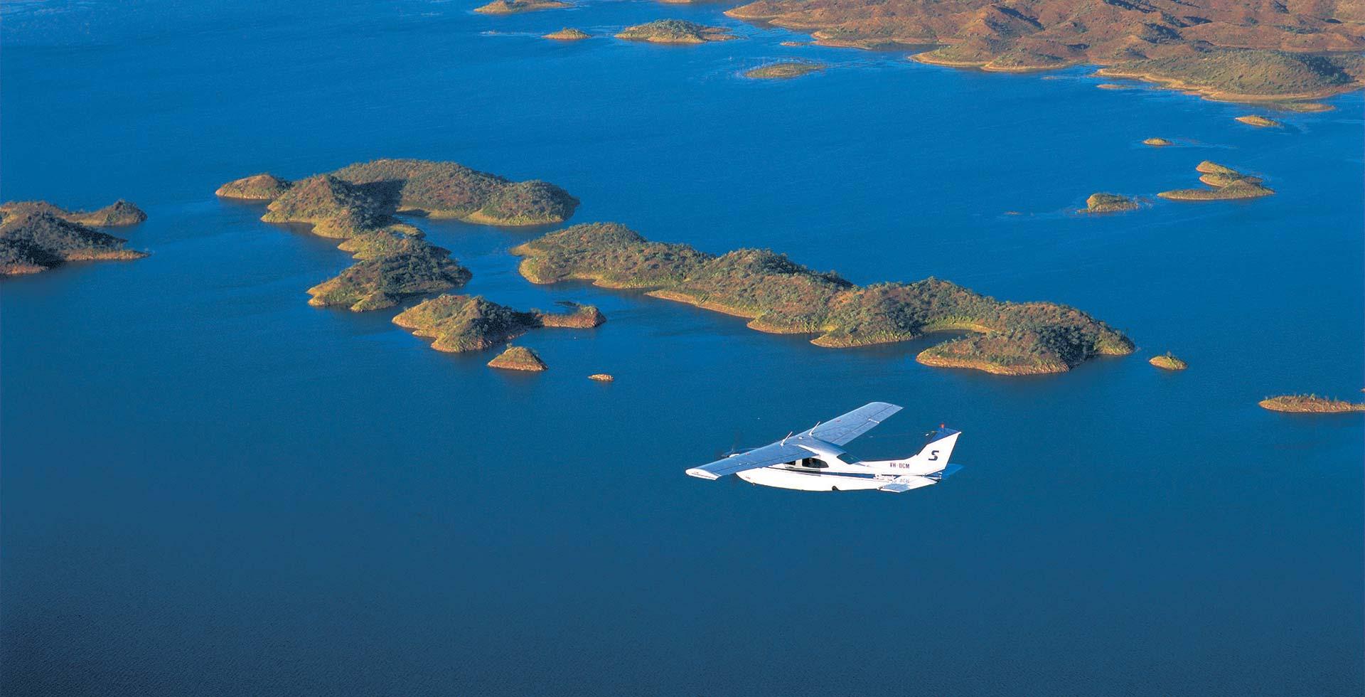 Fly across Lake Argyle near Kununurra and experience nature's beauty